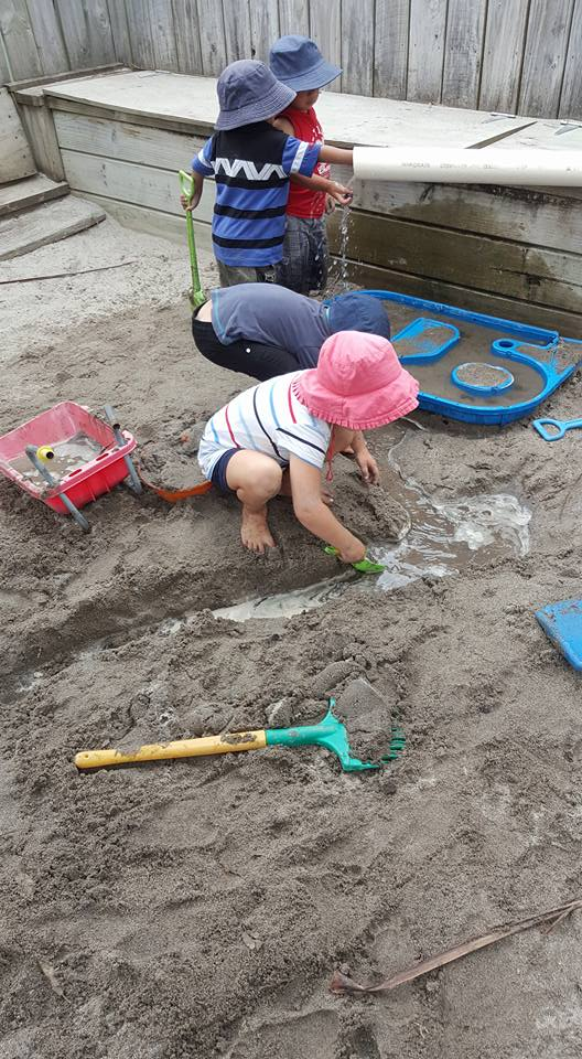 Making a river in the sandpit